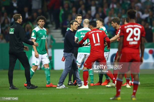 Niko Kovac head coach of Munich argues with a players and referees in the pitch during the DFB Cup semi final match between Werder Bremen and FC...