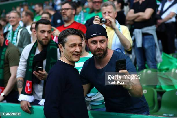 Niko Kovac head coach of Munich poses for a selfie with a fan prior to the DFB Cup semi final match between Werder Bremen and FC Bayern Muenchen at...