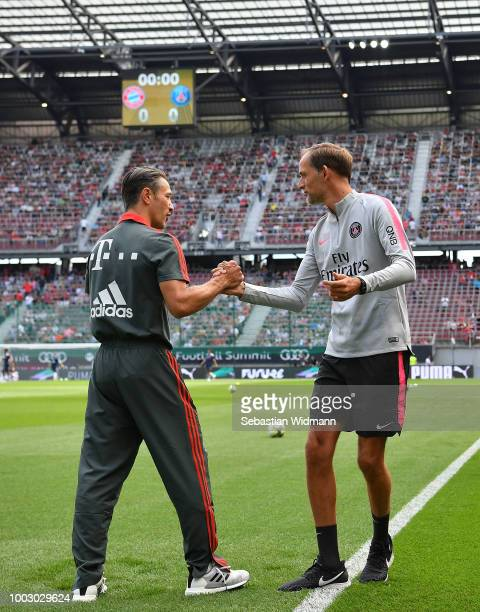 Niko Kovac Manager of Bayern Muich shakes hands with Thomas Tuchel Manager of PSG prior to kick off during the International Champions Cup 2018 match...