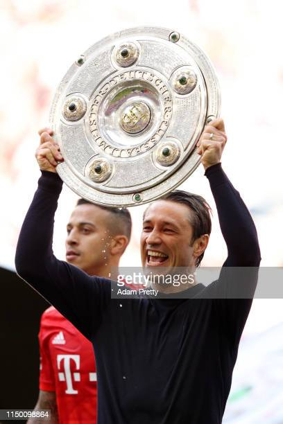 Niko Kovac Manager of Bayern Munich lifts the trophy following the Bundesliga match between FC Bayern Muenchen and Eintracht Frankfurt at Allianz...