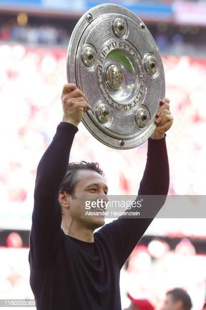 Niko Kovac, Manager of Bayern Munich lifts the trophy following the Bundesliga match between FC Bayern Muenchen and Eintracht Frankfurt at Allianz...