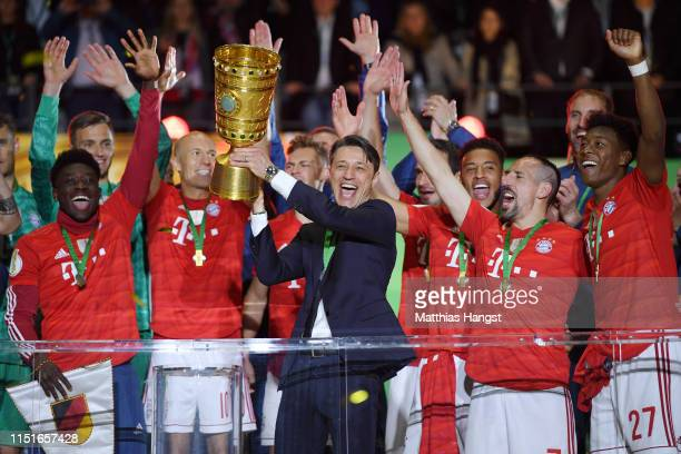 Niko Kovac, Manager of Bayern Munich lifts the trophy in celebration after the DFB Cup final between RB Leipzig and Bayern Muenchen at Olympiastadion...