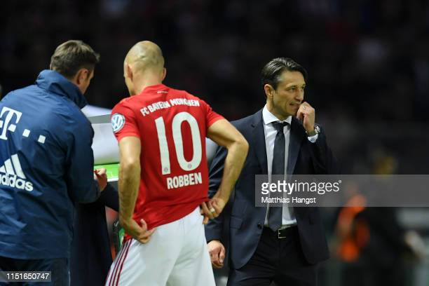 Niko Kovac Manager of Bayern Munich looks on during the DFB Cup final between RB Leipzig and Bayern Muenchen at Olympiastadion on May 25 2019 in...