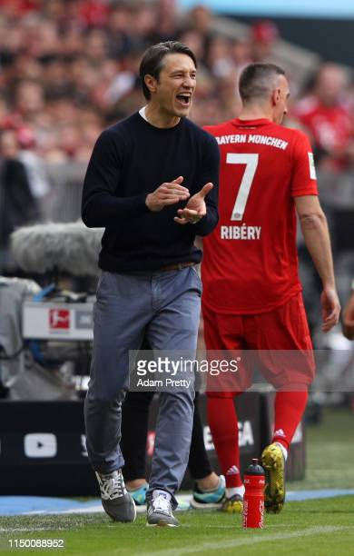 Niko Kovac Manager of Bayern Munich reacts as Franck Ribery of Bayern Munich waits to be substituted on during the Bundesliga match between FC Bayern...