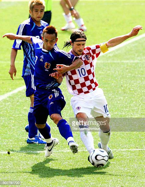Niko Kovac of Croatia and Hidetoshi Nakata of Japan compete for the ball during the FIFA World Cup Germany 2006 Group F match between Japan and...