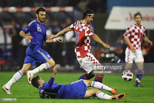 Niko Kranjcar of Croatia avoids the challenge from Konstantinos Katsouranis during the EURO 2012 Qualifying Group F match between Croatia and Greece...