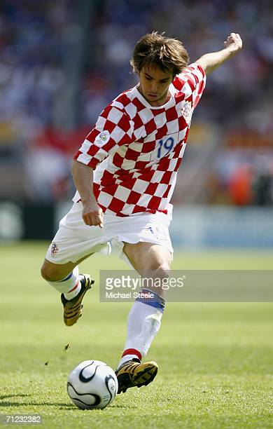 Niko Kranjcar of Croatia passes the ball during the FIFA World Cup Germany 2006 Group F match between Japan and Croatia at the Frankenstadion on June...