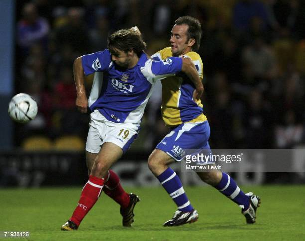 Niko Kranjcar of Portsmouth holds off Matthew Hampson of Mansfeld during the Carling Cup Second round match between Mansfield Town and Porstmouth at...