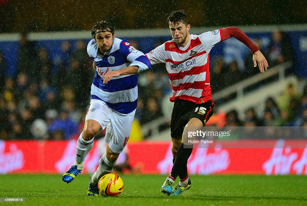 Niko Kranjcar of Queens Park Rangers is challenged by Liam Wakefield of Doncaster Rovers during the Sky Bet Championship match between Queens Park Rangers and Doncaster Rovers at Loftus Road on January 1, 2014 in London, England,