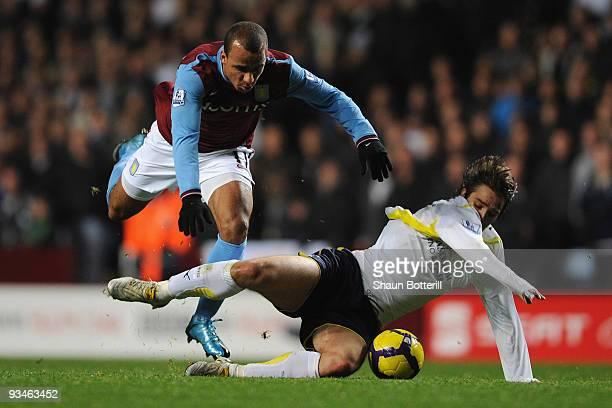 Niko Kranjcar of Tottenham Hotspur tangles with Gabriel Agbonlahor of Aston Villa during the Barclays Premier League match between Aston Villa and...