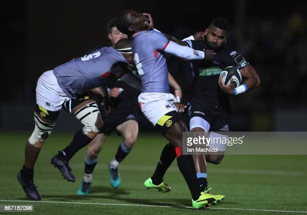 Niko Matawalu of Glasgow Warriors is tackled by Yaw Penxe of Southern Kings during the Glasgow Warriors and Southern Kings Guinness Pro 14 match at...