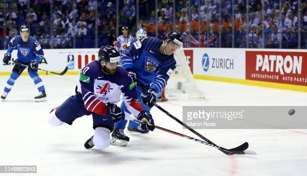 Niko Mikkola of Finland Robert Famer of Great Britain during the 2019 IIHF Ice Hockey World Championship Slovakia group A game between Finland and...