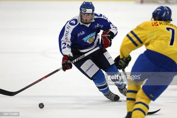 Niko Ojamaki of team Finland skates up ice against Julius Bergman of team Sweden during the U-18 Four Nations Cup game on November 7, 2012 at the Ice...