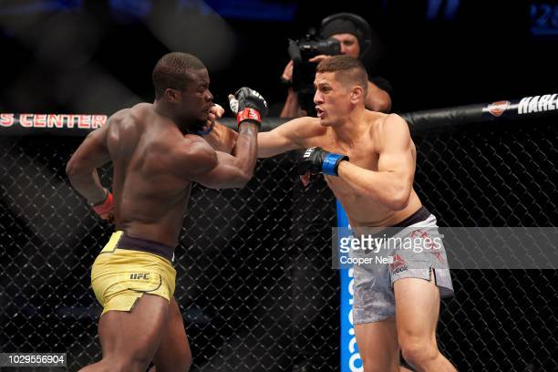 Niko Price connects with a punch against Abdul Razak Alhassan during the UFC 228 event at American Airlines Center on September 8 2018 in Dallas Texas