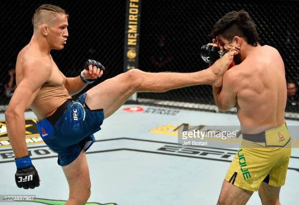 Niko Price kicks Vicente Luque in their welterweight fight during the UFC 249 event at VyStar Veterans Memorial Arena on May 09 2020 in Jacksonville...