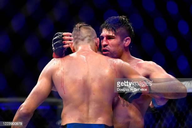 Niko Price of the United States congratulates Vicente Luque of the United States after their Welterweight fight during UFC 249 at VyStar Veterans...