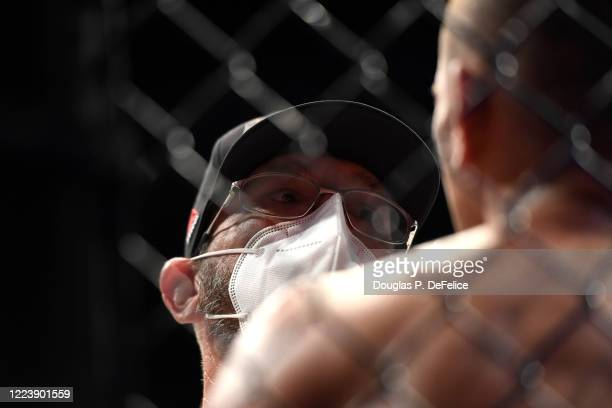 Niko Price of the United States is looked ove by a trainer against Vicente Luque of the United States in their Welterweight fight during UFC 249 at...