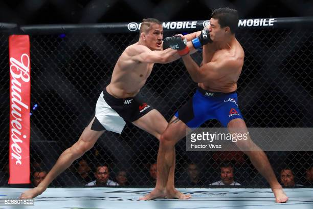 Niko Price of United States punches Alan Jouban of United States during the UFC Fight Night Mexico City at Arena Ciudad de Mexico on August 05 2017...