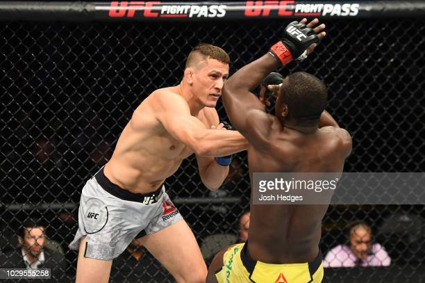 Niko Price punches Abdul Razak Alhassan of Ghana in their welterweight fight during the UFC 228 event at American Airlines Center on September 8 2018...