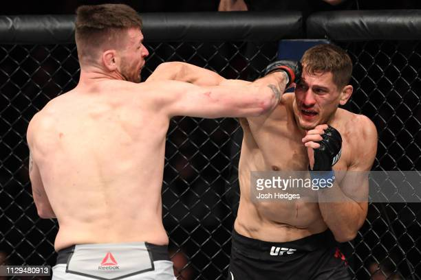 Niko Price punches Tim Means in their welterweight bout during the UFC Fight Night event at Intrust Bank Arena on March 9 2019 in Wichita Kansas