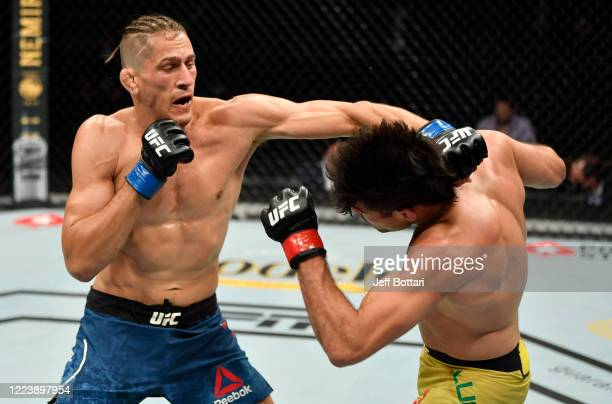 Niko Price punches Vicente Luque in their welterweight fight during the UFC 249 event at VyStar Veterans Memorial Arena on May 09 2020 in...