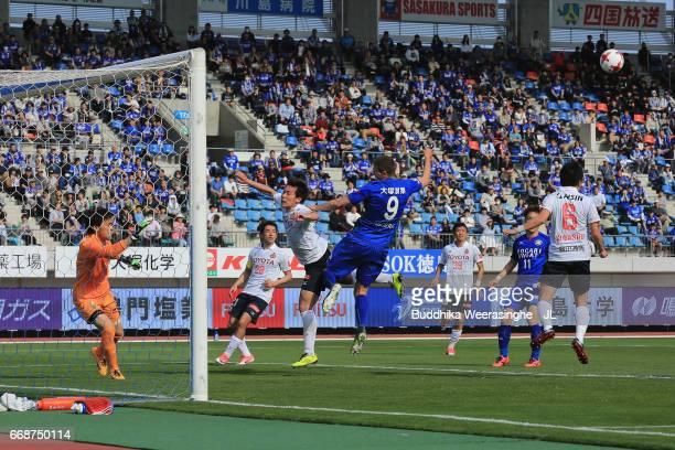 Nikola Asceric of Tokushima Vortis and Kazuki kushibiki of Nagoya Grampus compete for the ball during the J.League J2 match between Tokushima Vortis...