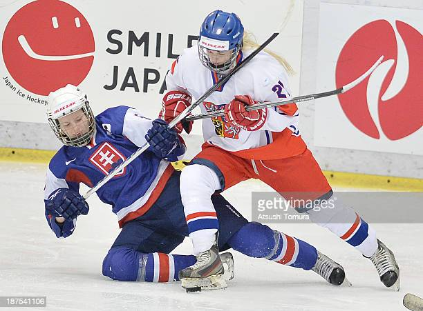 Nikola Balasova of Slovakia and Tereza Vanisova of Czech Republic battles for the puck in the match between Slovakia and Czech Republic during day...