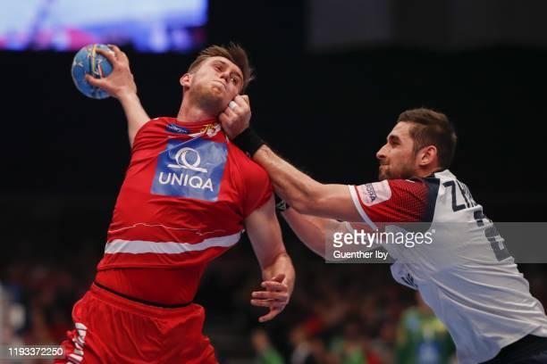 Nikola Bilyk of Austria and Stansilav Zhukov of Ukraine during the Men´s EHF EURO 2020 Group B match between Austria and Ukraine at Wiener Stadthalle...