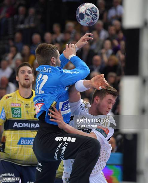 Nikola Bilyk of Kiel is challenged by Andreas Palicka of Rhein Neckar during the first leg round of 16 EHF Champions League match between THW Kiel...