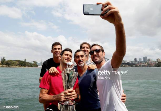 Nikola Cacic Novak Djokovic Nenad Zimonjic Dusan Lajovic and Viktor Troicki of Team Serbia pose with the ATP Cup during a media opportunity after...