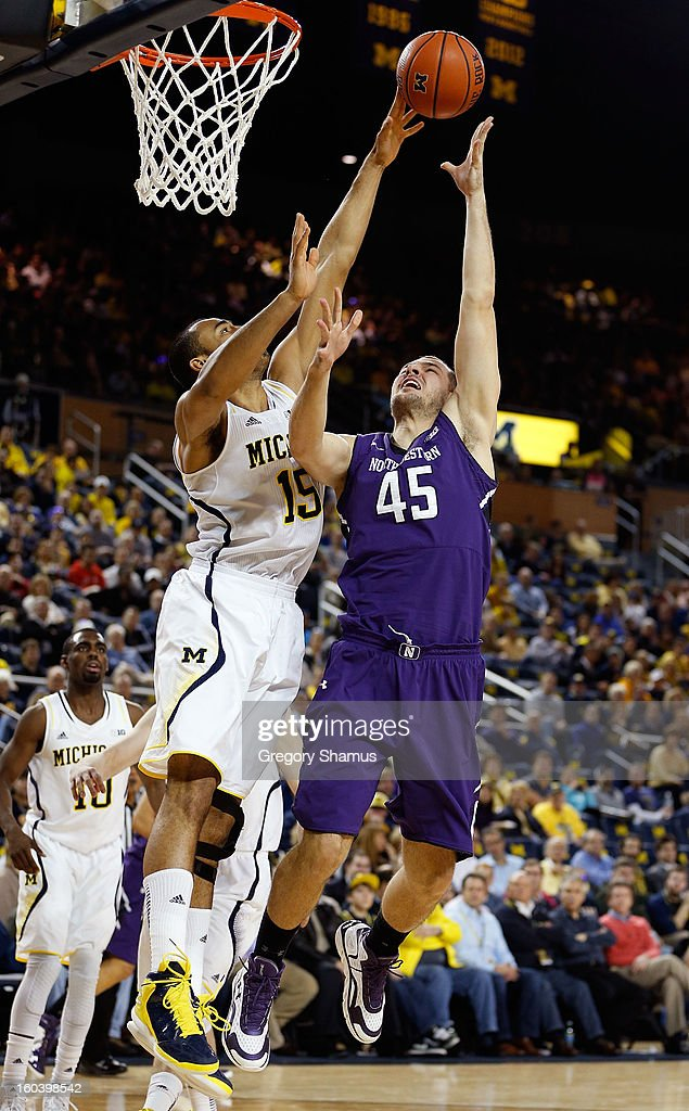 Nikola Cerina #45 of the Northwestern Wildcats gets his second half shot blocked by Jon Horford #15 of the Michigan Wolverines at Crisler Center on January 30, 2013 in Ann Arbor, Michigan. Michigan won the game 68-46.