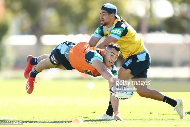 Nikola Cotric dives for a try as Cody Walker attempts to tackle during a New South Wales Blues State of Origin training session at NSWRL Centre of...