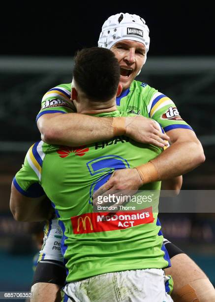 Nikola Cotric of the Raiders celebrates with team mate Jarrod Croker after scoring a try during the round 11 NRL match between the Parramatta Eels...