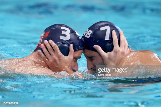 Nikola Dedovic and Strahinja Rasovic of Team Serbia celebrate the win during the Men's Gold Medal match between Greece and Serbia on day sixteen of...