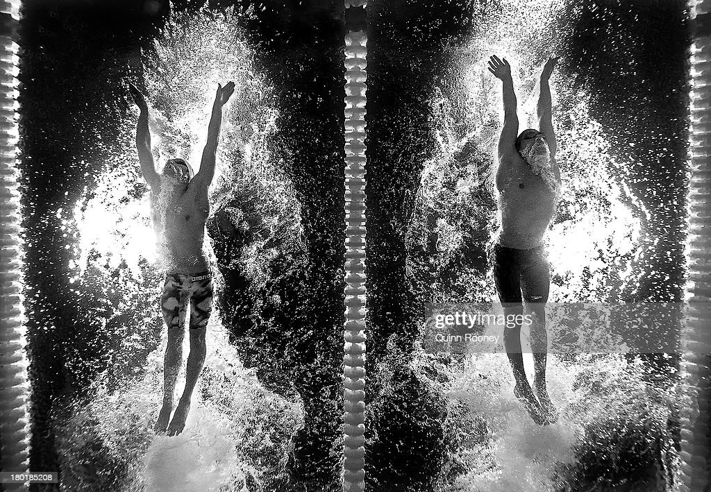 Nikola Dimitrov of Bulgaria and Alpkan Ornek of Turkey compete during the Swimming Men's 400m Individual Medley heat 1 on day sixteen of the 15th FINA World Championships at Palau Sant Jordi on August 4, 2013 in Barcelona, Spain.