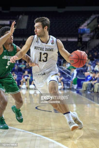 Nikola Djogo of the Notre Dame Fighting Irish drives to the basket in the game against the Jacksonville Dolphins in the second half at Purcell...