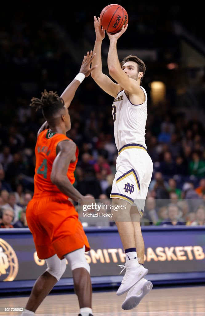 Nikola Djogo #13 of the Notre Dame Fighting Irish shoots the ball against Lonnie Walker IV #4 of the Miami (Fl) Hurricanes at Purcell Pavilion on February 19, 2018 in South Bend, Indiana.