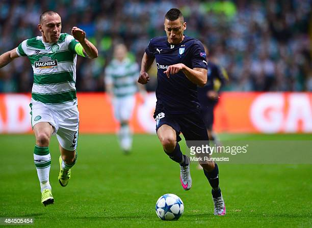 Nikola Djurdic of Malmo breaks free of Scott Brown of Celtic in a rare first half attack during the UEFA Champions League Qualifying playoff first...