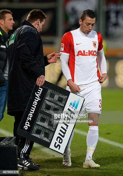 Nikola Djurdjic of Augsburg prepares for a substitution during the first Bundesliga match between FC Augsburg and Eintracht Frankfurt at SGL Arena on...
