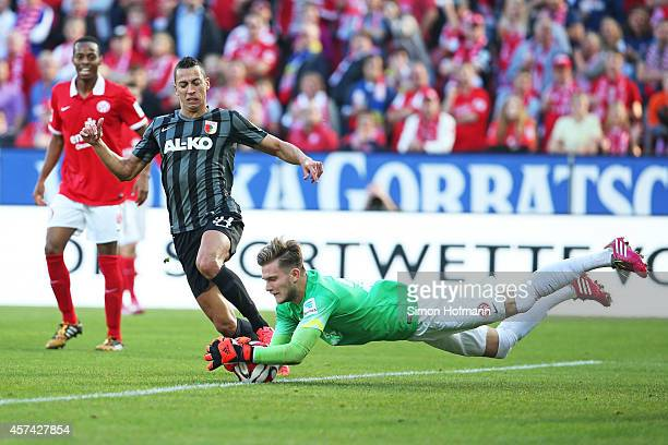 Nikola Djurdjic of Augsburg tries to score against goalkeeper Loris Karius of Mainz during the Bundesliga match between 1. FSV Mainz 05 and FC...