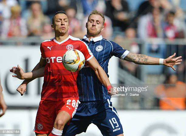 Nikola Djurdjic of Duesseldorf and Felix Burmeister of Bielefeld fight for the ball during the Second Bundesliga match between Arminia Bielefeld and...