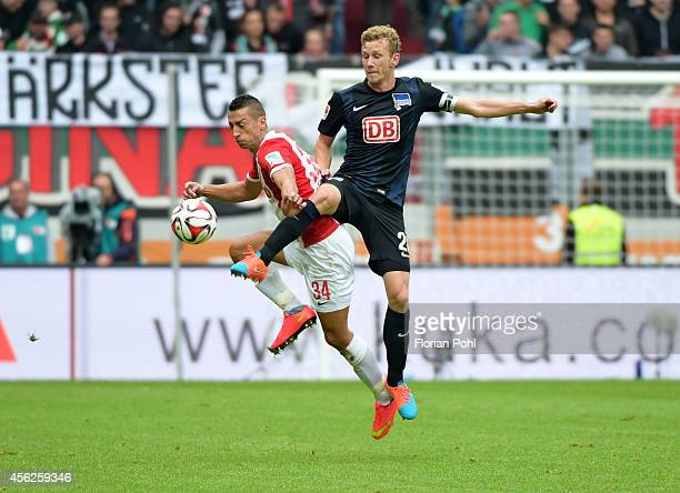 Nikola Djurdjic of FC Augsburg and Fabian Lustenberger of Hertha BSC during the game between FC Augsburg and Hertha BSC on September 28 2014 in...