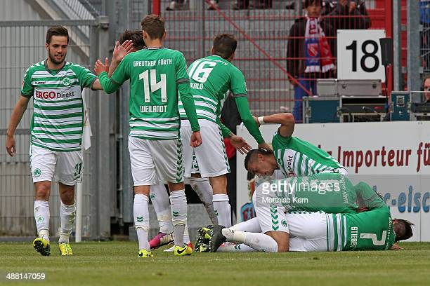 Nikola Djurdjic of Fuerth jubilates with team mates after scoring the third goal during the Second Bundesliga match between FC Energie Cottbus and...
