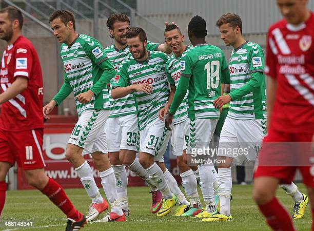 Nikola Djurdjic of Fuerth jubilates with team mates after scoring the sixt goal during the Second Bundesliga match between FC Energie Cottbus and...