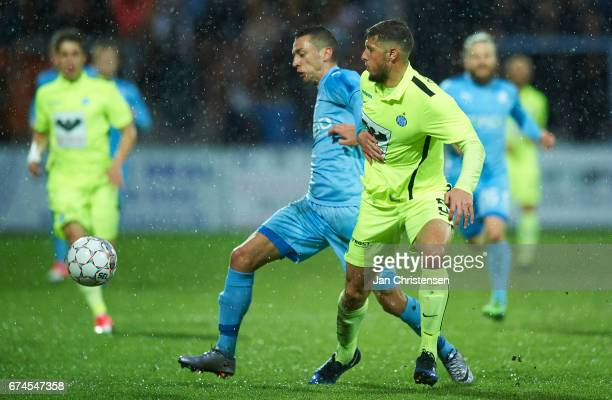 Nikola Djurdjic of Randers FC and Giorgos Katsikas of Esbjerg fB compete for the ball during the Danish Alka Superliga match between Randers FC and...