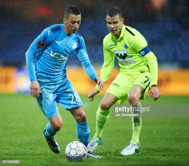 Nikola Djurdjic of Randers FC and Jesper Jorgensen of Esbjerg fB compete for the ball during the Danish Alka Superliga match between Randers FC and...