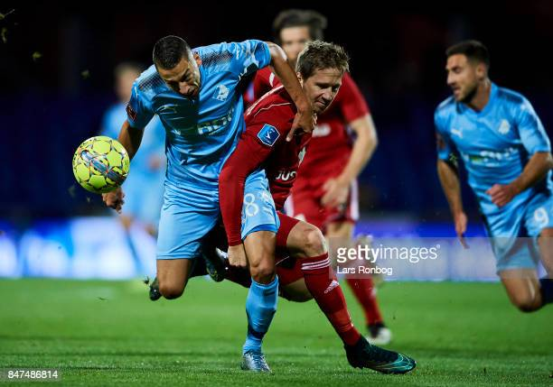 Nikola Djurdjic of Randers FC and Thomas Sorensen of Lyngby BK compete for the ball during the Danish Alka Superliga match between Randers FC and...