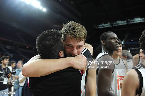 Nikola Doncic of Real Madrid celebrates with Paco Redondo head coach of Real Madrid during the Adidas Next Generation Tournament Final Game between...
