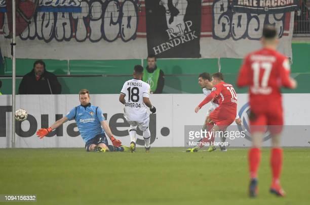 Nikola Dovedan of 1.FC Heidenheim 1846 scores his team's first goal during the DFB Cup match between 1. FC Heidenheim and Bayer Leverkusen at...