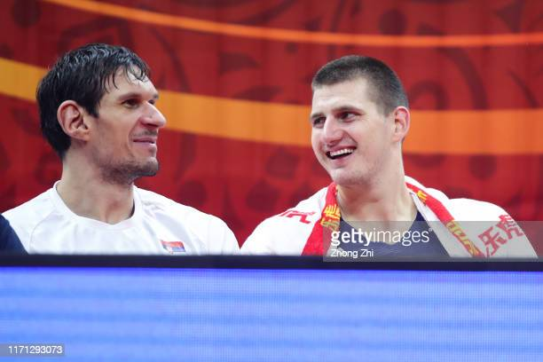 Nikola Jokic and Boban Marjanovic of the Serbia National Team react on the bench against the Angola National Team during the 1st round of 2019 FIBA...